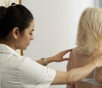female-osteopath-and-elderly-lady-